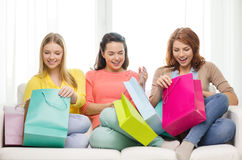 Smiling teenage girls with many shopping bags Royalty Free Stock Photos