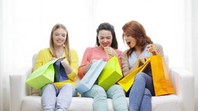 Smiling teenage girls with many shopping bags stock footage