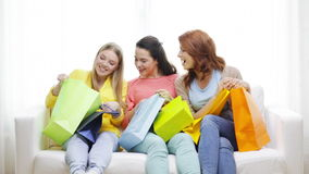 Smiling teenage girls with many shopping bags. Shopping and lifestyle concept - three smiling teenage girls with many shopping bags at home stock video footage