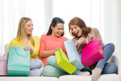 Smiling teenage girls with many shopping bags Royalty Free Stock Images