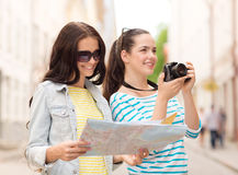 Smiling teenage girls with map Royalty Free Stock Image