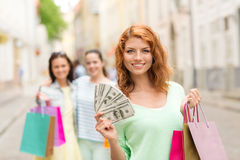 Smiling teenage girls with shopping bags on street Stock Photography