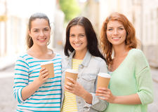 Smiling teenage girls with on street Royalty Free Stock Photo