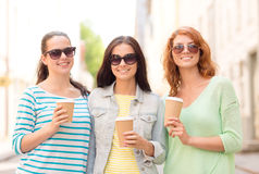 Smiling teenage girls with on street Stock Images