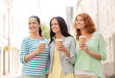 Smiling teenage girls with on street Royalty Free Stock Image