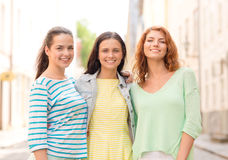 Smiling teenage girls with on street Royalty Free Stock Images