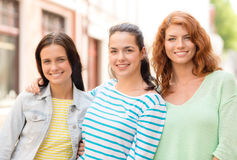 Smiling teenage girls with on street Royalty Free Stock Photography