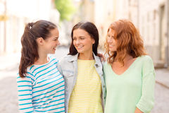 Smiling teenage girls with on street Stock Photos