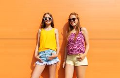 Smiling teenage girls in summer clothes outdoors Stock Photography