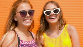 Smiling teenage girls in sunglasses outdoors stock footage