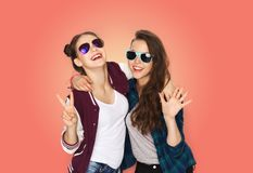 Smiling teenage girls in sunglasses showing peace stock photos