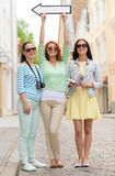 Smiling teenage girls with white arrow outdoors Stock Photography