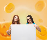Smiling teenage girls with white board Royalty Free Stock Images