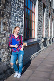 Smiling teenage student girl with backpack standing on street Royalty Free Stock Photo