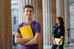 Smiling teenage student outdoors Royalty Free Stock Photos