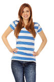 Smiling teenage woman with hands on hips Stock Photos