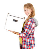 Smiling teenage woman keeping white box Royalty Free Stock Images