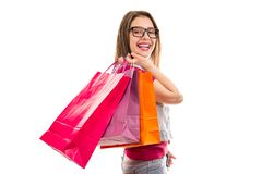 Smiling teenage woman with shopping bags royalty free stock images