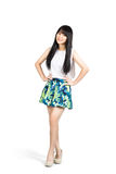 Smiling teenager asian girl standing Royalty Free Stock Image