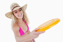 Smiling teenager in beachwear playing frisbee Stock Photos