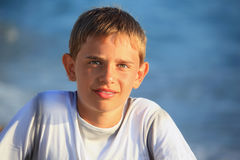 Smiling teenager boy against sea Stock Photo