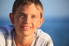 Smiling teenager boy against sea Royalty Free Stock Photos
