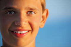 Smiling teenager boy against sea Royalty Free Stock Photography