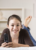 Smiling Teenager With Cellphone Stock Photography