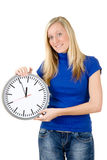 Smiling teenager with clock Stock Photos