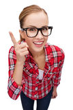 Smiling teenager in eyeglasses with finger up Royalty Free Stock Image
