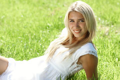 Smiling teenager in field Royalty Free Stock Images
