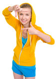 Smiling teenager girl framing with hands Royalty Free Stock Images