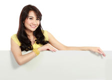 Smiling teenager girl holding blank white board Royalty Free Stock Images