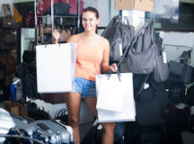 Smiling teenager girl holding shopping bags in boutique Royalty Free Stock Photography