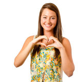 Smiling teenager girl making heart shape Stock Image
