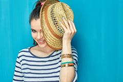 Smiling Teenager girl portrait with hat. On blue wall background Royalty Free Stock Photos