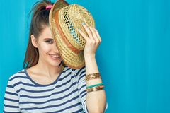 Smiling Teenager girl portrait with hat. On blue wall background Stock Photography