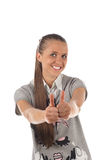 Smiling teenager girl portrait. Thumbs up! Stock Photo