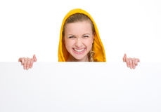 Smiling teenager girl showing blank billboard Royalty Free Stock Images