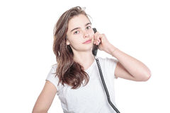 Smiling teenager girl talking on the phone Stock Photo