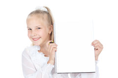 Smiling teenager girl with white blank. Beautiful blonde teenage girl holding white blank over white background Stock Photos
