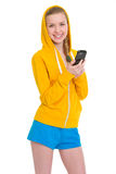 Smiling teenager girl writing sms Royalty Free Stock Image