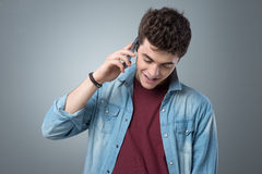 Smiling teenager having a phone call Stock Image