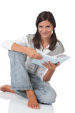 Smiling teenager holding book Stock Images