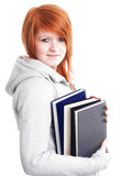 Smiling teenager holding books over white Royalty Free Stock Image