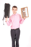 Smiling teenager holding a computer keyboard and abacus Royalty Free Stock Image