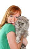 Smiling teenager holding her cat Stock Images