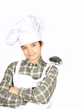 Smiling teenager with ladle in hand. Smiling person with ladle in hand Stock Images