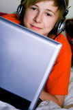 Smiling teenager with a laptop Royalty Free Stock Image