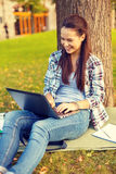 Smiling teenager with laptop Stock Photo